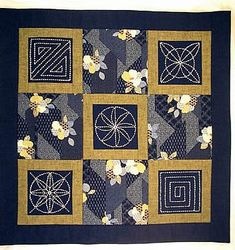 quilt with sashiko-embroidered blocks