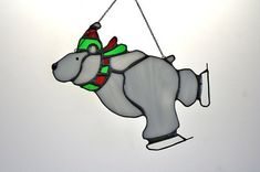 A whimsical polar bear on ice skates. Brings a little smile to the long winter. Measures 7 x 5 and is equipped with two hanging eyes and black chain.
