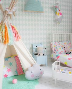 Mix sunny yellows, neon pink, and brilliant blue with its pastel counterparts to create a cute space.   A Neutral and Neon Nursery   Kids Design Life