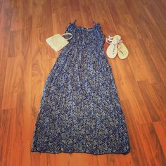 NWOT Floral maxi dress Lightweight flowy maxi dress with blue floral design. Very chic ties on the shoulders and stretchy gusset under bust area. Perfect summer staple dress. Fits size M to L. Gusset is very stretchy. New without tags Boutique Dresses Maxi