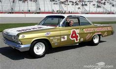 1960 NASCAR Grand National Champion Rex White with a replica of his 1962 Chevy Impala