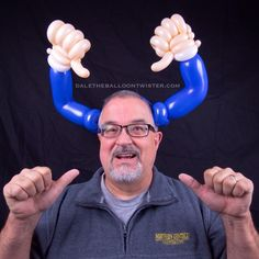 Who has four thumbs and twists balloons? THIS GUY!!!