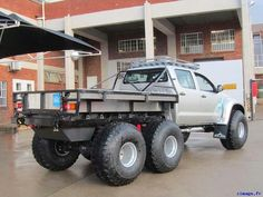 6x6 Toyota Hilux..  Arctic Trucks builds some cool rigs. To work for them building and designing trucks for expeditions to Antarctica would be a kick ass job !