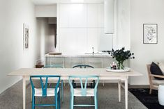 Mix n match wishbone chairs...Residence In Prahran, Victoria, Australia