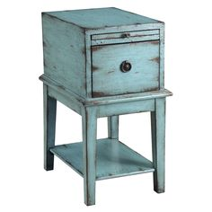 In a weathered and distressed sea blue finish, this simple cabinet has a bold personality full of rustic charm. One single deep drawer has a decorative pull and there is a pullout tray to extend the area on top. Coastal furniture   blue beach decor #coastal #beach