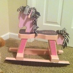 Rocking horse I made Olivia. The horse came from Michael's and I used paint, scrapbook paper, modge podge and ribbon to decorate.