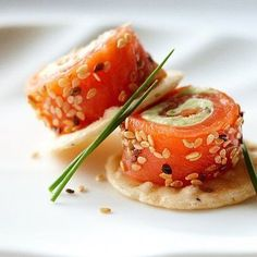 Ingredients 8 oz (250 g) block cream cheese 2 tbsp (30 mL) snipped fresh chives 1 lime 1/2 very ripe avocado, peeled 5 oz (150 g) pkg wild smoked salmon, about 12 slices 2 tbsp (30 mL) sesame seeds (optional)