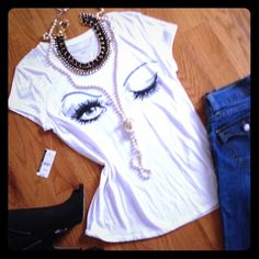 BNWT Fun White New York & Co Winking Eye Tee Brand NEW WITH TAGS. Never worn. Super soft 100% cotton. Not sure I want to sell this one (because it's too cute!) so price is firm. Reposh from another awesome seller but I haven't had the chance to wear it (yet!). Flattering cap sleeves and scoop neck. Bling on eyelashes. Would look great with skinny jeans or black leggings. Labeled L but would fit a M/L. Measurements lying flat: 17- 17.5 in across chest, 26.5 in from top of shoulder to hem…
