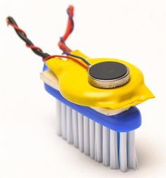 """Teach kids about making, working with basic electronics, and thinking outside the box in minimalist """"robot"""" design with the MAKE BrushBot Kit. Inspired by the original Bristlebot how-to from our friends at Evil Mad Scientist Laboratories, the BrushBot uses the head of a toothbrush as its body and the bristles as its legs. The hundreds of nylon hairs twitch and vibrate to make the """"bot"""" bounce along like a nervous little insect. A tiny pager motor and coin cell battery provide the get up and…"""