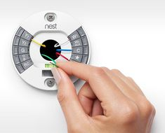 """NEST 2.0: The coolest part is the redesigned installation process/parts: """"We upgraded our easy-to-use press connectors to make inserting heating and cooling wires even faster, then moved the screw holes to the top and bottom to make installation simpler. And of course the exclusive built-in level is included in this Nest as well."""""""