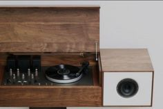 """The flagship of the Symbol audio line, the Modern Record Console pays homage to """"all in one"""" console hifi's of the 1950's, an idea whose time, we believe, has come around again. Each cabinet is individually crafted in the tradition of fine bench-made furniture from solid American Walnut."""