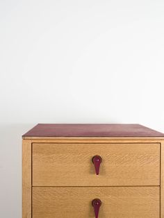 The Zacate Chest, shown here in oil-rubbed white oak and oxblood leather hardware (detail)