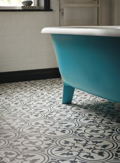 Audrey bath painted in South Bank with Toulouse Pont Neuf floor tiles www.firedearth.com/audrey-freestanding-bath