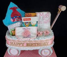 Wagon Diaper Cake Made for a 1st Birthday www.facebook.com/DiaperCakesbyDiana
