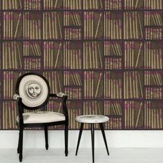EX LIBRIS Wallpaper. A now iconic design inspired by a 1953 screen, Ex Libris is a basic print of a faux library full of character. Books bound in pigskin and buff on black shelves; pale sepia on silver books with dark stone shelves; parchment on black and white books with pale taupe shelves and for lovers of purple prose, magenta and gold books on black shelves. Design Is Inspired By Everything.