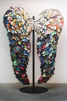 via Heather B.   Alfredo and Isabel Aquilizan, Last Flight, 2009  Used rubber slippers  The husband-and-wife team of Isabel and Alfredo Aquilizan creates works that use the processes of collecting and collaborating to express ideas of migration, family and memory. Often working with local communities, the Aquilizans bring together personal items to compose elaborate, formal installations reflecting individual experiences of dislocation and change.