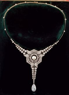 Art Deco necklace, by Maison Briquet, Place Vendôme. The necklace centring a fine pearl in a fine openwork geometrical Art Deco setting surrounded by brilliant-cut diamonds, suspending a pear-shaped diamond weighing 2.78 carats, mounted in white gold.