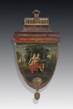 Crest shaped tole-peinte wall fountain depicting a romantic scene