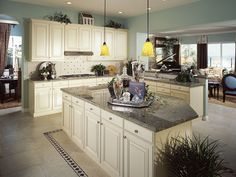 Cream cabinet kitchen with gray granite counter island