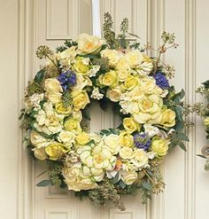 Wreath with pale yellow & cream roses & hints of blue..would look so pretty on my newly Blue painted door! :)