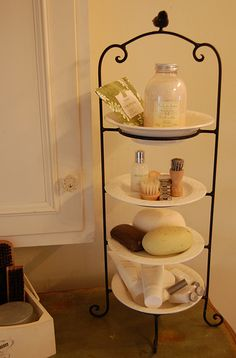 Love this idea for a guest bathroom. CLEVER IDEA: use a plate stand to create extra space on bathroom counter.