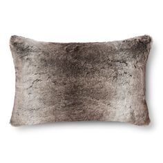 """• Faux fur<br>• Silky-soft polyester exterior<br>• Plush polyester fill<br>• Lumbar/bolster pillow<br>• Spot clean only<br>• Dimensions: 22"""" L x 14"""" W<br><br>You and your guests will go wild for a Fieldcrest Luxury, Oblong Fur Pillow. This one-of-a-kind accent pillow strikes the perfect balance of pretty and practical for a look and feel you'll love to snuggle up with. Combine it..."""