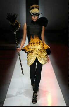 Bunmi Olaye and partner Francis Udom, won 'Emerging Designer of the Year 2010 - International' at Africa Fashion Week... Fire this dress is smoking hot
