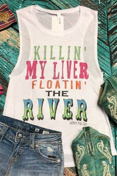 Our 'Floating Down the River Bro Tank' is a white bro tank with 'Killing my liver, floating down the river' on the front in multi-colors, with Southern Fried Chics underneath. You can choose to have it blinged out with REAL Swavorski Crystals for $12.