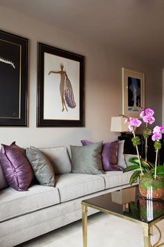 Erte prints and a beautiful colour palette How To Use Purple In Stunning Looking Living Rooms