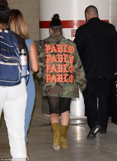 Representing:As Los Angeles is currently experiencing cool evenings, Kim was forced to add a jacket to her daring look picking a camouflage print coat from husband Kanye West's Pablo tour merchandise collection