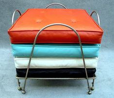 Mid-Century Modern •~• vintage black, orange, turquoise, & white floor cushions and holder