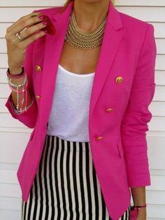 bright pink blazer and gold accessories