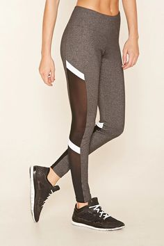 A pair of marled stretch-knit leggings with colorblocked mesh-paneled sides, moisture management, a hidden key pocket, and an elasticized waist. #f21active