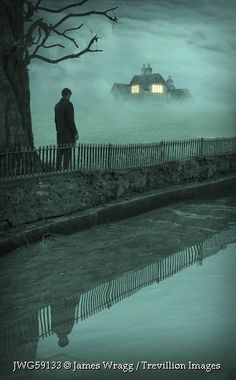 Trevillion Images - man-by-spooky-house-in-mist