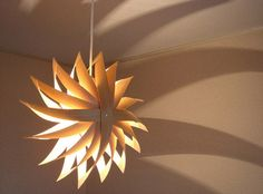 """""""Wappa Shade"""" created by Toshiyuki Tani.    The unique shape of the shade is formed in the image of a """"Kazaguruma (pinwheel)"""" being spun around by the wind."""