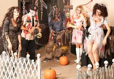Definitely out favorite Halloween Party Theme : Zombie Apocalypse.   A patch of pumpkins and a creepy wooden fence prop, complete with skulls, helped to set the proper Halloween ambiance. #partyideas #Halloween #OrangeTuesday @BuyCostumes #ad