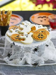 Present your cookies on a haunting cake stand that's draped with gauze. Place plastic spiders around the gauze for an extra spooky effect.