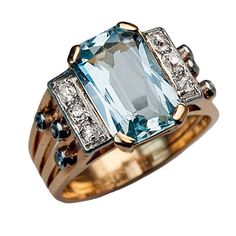 Art Deco Aquamarine Diamond Ring. Circa 1930s  An 18K gold ring features a sparkling cool blue aquamarine (approximately 2.73 ct) flanked by two platinum panels vertically-set with six cushion shaped diamonds. The shoulders of the ring are embellished with six bezel-set round diamonds. The estimated total diamond weight is 0.30 ct. The ring is marked with French owl mark for imported gold jewelry.