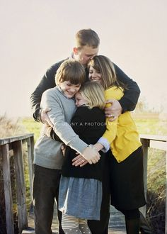 love this for a family photo...how the arms make a heart <3