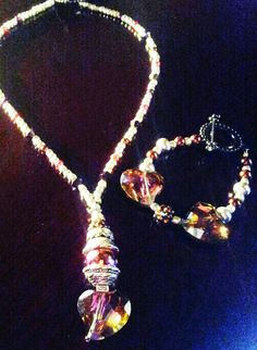 Drop heart necklace with matching bracelet.