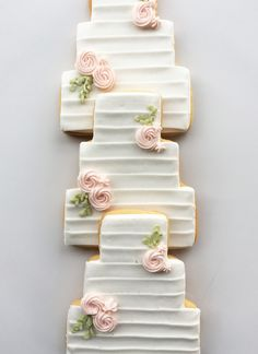 Wedding cake cookie favors by Whipped Bakeshop in Philadelphia. Wedding Shower Cookies, Wedding Cake Cookies, Cookie Wedding Favors, Cookie Favors, Wedding Cake Decorations, Birthday Cookies, Decorated Wedding Cookies, Bridal Shower, Wedding Cookie Recipes