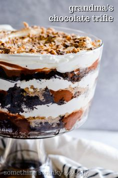 Famous Chocolate Trifle My grandmother's recipe for a family favorite. Layers of chocolate cake, pudding, Cool Whip, and Heath Toffee Bits make this the most incredible holiday dessert ever! We gobble this up every time my grandma sets it on the table. Layered Desserts, Mini Desserts, Christmas Desserts, Delicious Desserts, Dessert Recipes, Christmas Cupcakes, Christmas Trifle, Classic Desserts, Gourmet Desserts