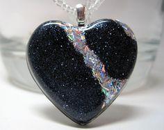 Handmade Black Glitter and Holographic Silver Glitter Stripe Resin Heart Pendant.