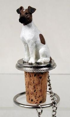 Shop for black and white Fox Terrier sitting on top of a unique, decorative, wine cork bottle stopper. Fits a standard size wine or champagne bottle.