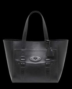 This eye-catching cruelty-free vegan leather tote carryall with the playful  embossed trompe 7fd0d7b3f4