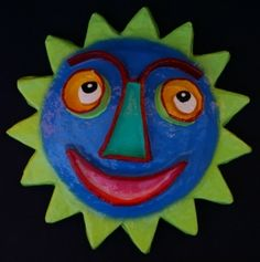 Paper Mache Sun Face. Nothing goes to waste in Haiti so these old cement bags when finished carrying cement become used in whimsical sun faces