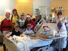 Jockeys (kneeling) Keiber Coa and Pablo Morales; and (standing, left to right) Dean Butler, Antonio Gallardo, Janelle Campbell, Daniel Centeno and Ronnie Allen, Jr., visit a patient in the Neurology Unit of All Children's Hospital in St. Petersburg. Also pictured is Sharyn Wasiluk of the Tampa Bay Downs Division of the Race Track Chaplaincy of America. Allchildren Hospital #allchildrens #jockeysguild #racetrackchaplaincyofamerica