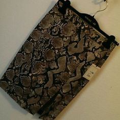 NWT Altuzarra skirt Snake print pencil skirt, with a slit in the front. $37 includes tax. Altuzarra Skirts
