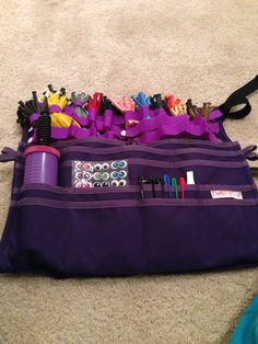 Balloon twisting apron from twist Em up. I like the purple one.