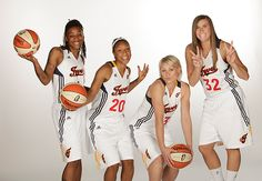 Briann January #20 poses with Shavonte Zellous, Erin Phillips, and Jeanette Pohlen during the Fever Media Day on May 19, 2011.